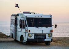 Old vintage caravan. Standing in front of the ocean Royalty Free Stock Photo