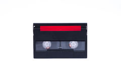 Old video camera cassette digital, black with red tape cover Stock Photography