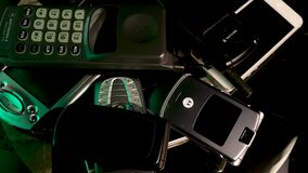 Old Vintage Cellular Mobile Phones From 1990s and 2000s. Spinning Close Up