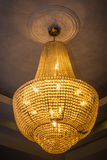 Old vintage chandelier with gold lights.  royalty free stock photography