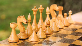 Old Vintage Chess Standing On Chessboard Stock Photos
