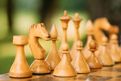 Old Vintage Chess Standing On Chessboard Royalty Free Stock Photography