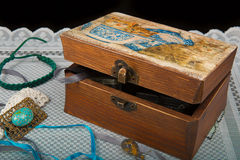 Old vintage chest of patterns on the tablecloth with old things Royalty Free Stock Photo