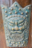 The old vintage Chinese figure of iron monster face Stock Image
