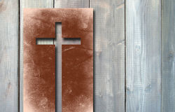 Old vintage Christian paper cross on wood background Stock Image