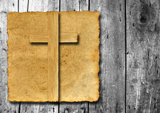 Old vintage Christian paper cross on wood Stock Images