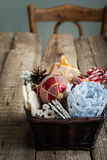 Old Vintage Christmas Gifts in a Basket Royalty Free Stock Photos
