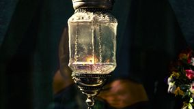 Old vintage church glow lamp with candle inside. Antique religious decoration of the east and west lantern. Holy fire as a symbol vector illustration