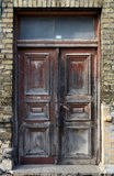 Old vintage city house door. Street view in an old city house Royalty Free Stock Images