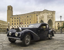 Old vintage classic car bugatti lecce. Old vintage classic car bugatti on the road Stock Photos