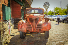 old vintage classic retro truck parked against brick building at Toronto distillery historic district Stock Image