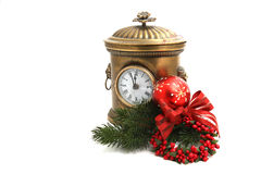 Old vintage clock decorated with Christmas ball Stock Photos