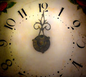 Old vintage clock. Old hand painted vintage clock showing hours stock image