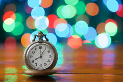 Old vintage clock have colorful bokeh as background Stock Photos