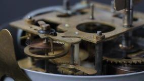 Close up of a internal clock mechanism, closeup shot with soft focus. Old vintage clock mechanism working, closeup shot with soft focus. Close up of a internal stock footage