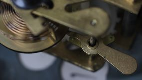 Old vintage clock mechanism working, closeup shot with soft focus. Close up of a internal clock mechanism. Vintage Watch Gears. Old vintage clock mechanism stock video footage