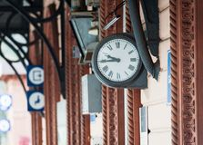 Old vintage clock at rail station wall of Varenna town, Lombardy, Italy Royalty Free Stock Images
