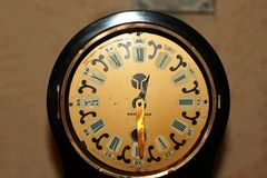 Old vintage clock with roman numerals on the dial. Old vintage clock with roman numerals on the dial stock photo