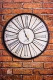 Old vintage clock on textured brick wall Royalty Free Stock Photos