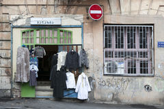 Old vintage clothing for sale near the commissary. TBILISI, GEORGIA, 16 AUGUST, 2016: old vintage clothing for sale near the antic shop Royalty Free Stock Image