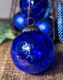 Old vintage cobalt blue Christmas tree balls from glass. Close up Royalty Free Stock Photo