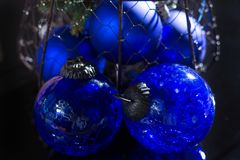 Old vintage cobalt blue Christmas tree balls from glass. Close up Stock Photos