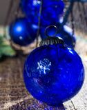 Old vintage cobalt blue Christmas tree balls from glass. Close up Royalty Free Stock Image