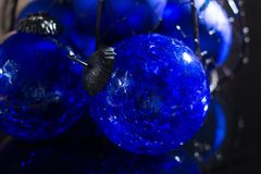 Old vintage cobalt blue Christmas tree balls from glass. Close up Stock Image
