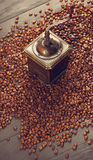 Old vintage coffee mill on roasted hot beans Stock Photography