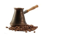 Old vintage coffee pot and brown beans Royalty Free Stock Photos