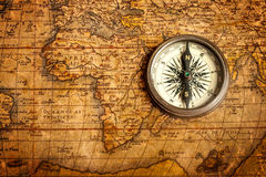 Old vintage compass on ancient map Royalty Free Stock Photography