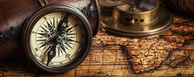 Old vintage compass on ancient map Stock Photography