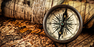 Old vintage compass on ancient map Stock Photos