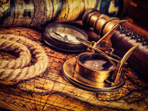 Old vintage compass on ancient map Royalty Free Stock Image
