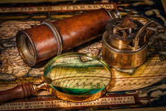 Old vintage compass on ancient map Stock Image