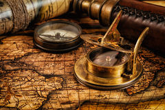 Old vintage compass on ancient map Royalty Free Stock Photo