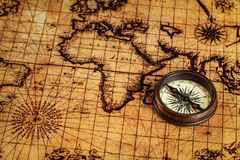 Old vintage compass on ancient map Stock Images