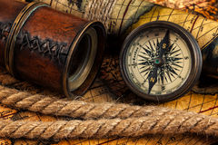 Old vintage compass and navigation instruments on ancient map Royalty Free Stock Image