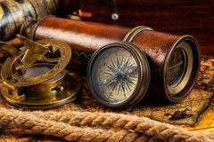 Old vintage compass and navigation instruments on ancient map Stock Images
