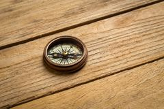 Old vintage compass on the table. Concept of travel royalty free stock images