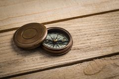 Old vintage compass on the table. royalty free stock images