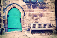 Old and vintage concept. Old doors and bench in creamy pastel vintage picture Royalty Free Stock Image