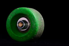 Old Vintage Consumed Skate Wheel. On a Black Background Royalty Free Stock Photos
