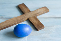 Old vintage cross and abstract blue easter egg. Symbol simple idea Stock Photos