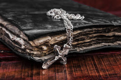 Old Vintage Cross. Closeup of silver Christian cross on bible royalty free stock photo