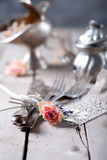 Old vintage cutlery bound with a rope, dried rose Royalty Free Stock Photography
