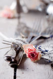 Old vintage cutlery bound with a rope, dried rose. Old vintage cutlery bound with a rope, decorated with dried rose and lace and vintage sugar bowls on a wooden royalty free stock photo