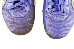 Old vintage damaged futsal sports shoes on white background football sportware object isolated