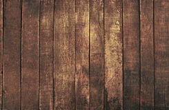 Old vintage dark brown wooden planks background. Old vintage aged grunge dark brown wooden floor planks texture background with stains and nails Stock Photo
