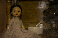 Old vintage doll is in the closet. Stock Photography